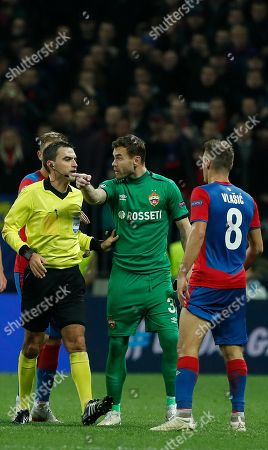 Goalkeeper Igor Akinfeev of PFC CSKA (C) argues with Romanian referee Ovidiu Hategan (L) during the UEFA Champions League group G soccer match between PFC CSKA Moskva and Real Madrid CF at the Luzhniki stadium in Moscow, Russia, 02 October 2018.