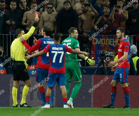 Referee Ovidiu Hategan of Romania shows the red card to goalkeeper Igor Akinfeev (2R) of PFC CSKA during the UEFA Champions League group G soccer match between PFC CSKA Moskva and Real Madrid CF at the Luzhniki stadium in Moscow, Russia, 02 October 2018.