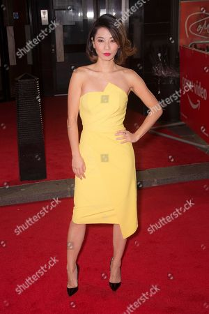 Jing Lusi poses for photographers upon arrival for the Premiere of 'The Romanoffs', at a central London cinema