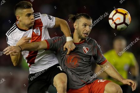Rafael Borre of Argentina's River Plate, left, and Gaston Silva of Argentina's Independiente battle for the ball during a Copa Libertadores quarterfinal soccer match in Buenos Aires, Argentina