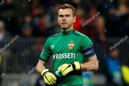 CSKA goalkeeper Igor Akinfeev prepares to drink during their Champions League Group G soccer match between CSKA Moscow and Real Madrid in Moscow, Russia
