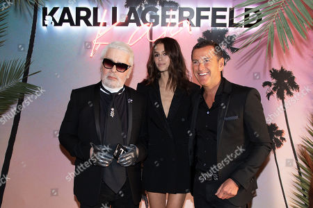 Stock Picture of Karl Lagerfeld (L), Kaia Gerber (C) and Pier Paolo Righi (R) celebrate the launch of the Karl x Kaia collaboration capsule collection during the Paris Fashion Week, in Paris, France, 02 October 2018. The presentation of the Women's collections runs from 24 September to 02 October 2018.
