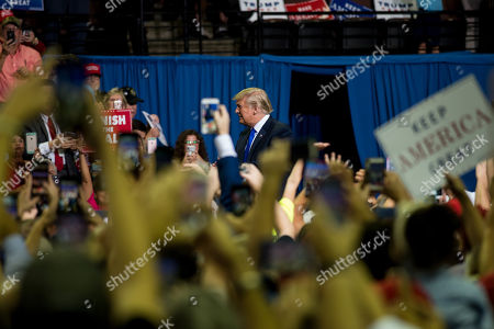 US President Donald J. Trump (C) greets supporters at a Make America Great Again rally at the Landers Center in Southaven, Mississippi, USA, 02 October 2018. President Trump has been holding MAGA rallies around the country supporting Republican candidates and speaking about what he believes are the accomplishment of his administration. During this rally, President Trump made statements mocking the testimony of Dr. Christine Blasey Ford, who has accused Supreme Court nominee Brett Kavanaugh of allegedly sexually assulting her when they were in high school.