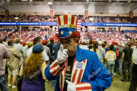 A supporter of US President Donald J. Trump walks through the crowd dressed as Uncle Sam at a Make America Great Again rally at the Landers Center in Southaven, Mississippi, USA, 02 October 2018. President Trump has been holding MAGA rallies around the country supporting Republican candidates and speaking about what he believes are the accomplishment of his administration. During this rally, President Trump made statements mocking the testimony of Dr. Christine Blasey Ford, who has accused Supreme Court nominee Brett Kavanaugh of allegedly sexually assulting her when they were in high school.