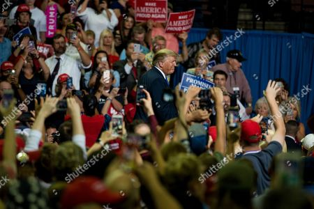 US President Donald Trump (C) walks off stage after a Make America Great Again rally at the Landers Center in Southaven, Mississippi, USA, 02 October 2018. President Trump has been holding MAGA rallies around the country supporting Republican candidates and speaking about what he believes are the accomplishment of his administration. During this rally, President Trump made statements mocking the testimony of Dr. Christine Blasey Ford, who has accused Supreme Court nominee Brett Kavanaugh of allegedly sexually assulting her when they were in high school.