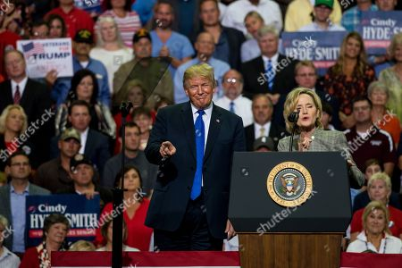 US President Donald J. Trump (C-L) and US Senator Cindy Hyde-Smith (R) address supporters at a Make America Great Again rally at the Landers Center in Southaven, Mississippi, USA, 02 October 2018. President Trump has been holding MAGA rallies around the country supporting Republican candidates and speaking about what he believes are the accomplishment of his administration. During this rally, President Trump made statements mocking the testimony of Dr. Christine Blasey Ford, who has accused Supreme Court nominee Brett Kavanaugh of allegedly sexually assulting her when they were in high school.