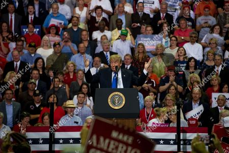 US President Donald J. Trump (C) speaks at a Make America Great Again rally at the Landers Center in Southaven, Mississippi, USA, 02 October 2018. President Trump has been holding MAGA rallies around the country supporting Republican candidates and speaking about what he believes are the accomplishment of his administration. During this rally, President Trump made statements mocking the testimony of Dr. Christine Blasey Ford, who has accused Supreme Court nominee Brett Kavanaugh of allegedly sexually assulting her when they were in high school.