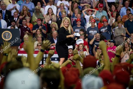 A staffer throws hats to the crowd before a speech by US President Donald Trump at a Make America Great Again rally at the Landers Center in Southaven, Mississippi, USA, 02 October 2018. President Trump has been holding MAGA rallies around the country supporting Republican candidates and speaking about what he believes are the accomplishment of his administration. During this rally, President Trump made statements mocking the testimony of Dr. Christine Blasey Ford, who has accused Supreme Court nominee Brett Kavanaugh of allegedly sexually assulting her when they were in high school.