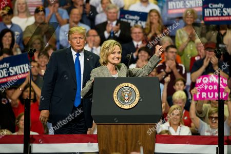 US Senator Cindy Hyde-Smith (R) speaks beside US President Donald J. Trump (L) at a Make America Great Again rally at the Landers Center in Southaven, Mississippi, USA, 02 October 2018. President Trump has been holding MAGA rallies around the country supporting Republican candidates and speaking about what he believes are the accomplishment of his administration. During this rally, President Trump made statements mocking the testimony of Dr. Christine Blasey Ford, who has accused Supreme Court nominee Brett Kavanaugh of allegedly sexually assulting her when they were in high school.