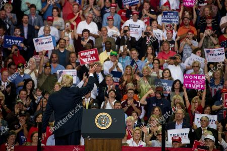 US President Donald J. Trump waves to supporters at a Make America Great Again rally at the Landers Center in Southaven, Mississippi, USA, 02 October 2018. President Trump has been holding MAGA rallies around the country supporting Republican candidates and speaking about what he believes are the accomplishment of his administration. During this rally, President Trump made statements mocking the testimony of Dr. Christine Blasey Ford, who has accused Supreme Court nominee Brett Kavanaugh of allegedly sexually assulting her when they were in high school.