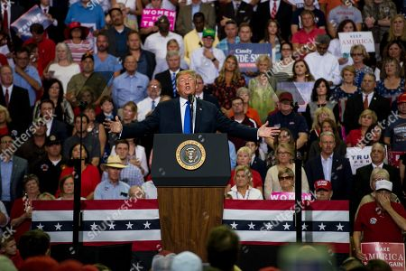 US President Donald J. Trump (C) addresses supporters at a Make America Great Again rally at the Landers Center in Southaven, Mississippi, USA, 02 October 2018. President Trump has been holding MAGA rallies around the country supporting Republican candidates and speaking about what he believes are the accomplishment of his administration. During this rally, President Trump made statements mocking the testimony of Dr. Christine Blasey Ford, who has accused Supreme Court nominee Brett Kavanaugh of allegedly sexually assulting her when they were in high school.