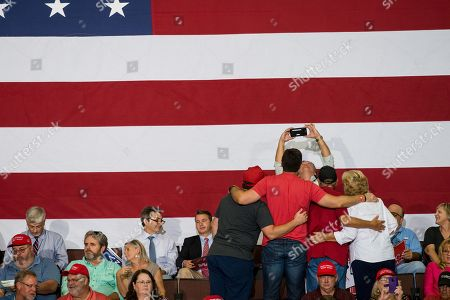 Supporters of US President Donald J. Trump take photographs at a Make America Great Again rally at the Landers Center in Southaven, Mississippi, USA, 02 October 2018. President Trump has been holding MAGA rallies around the country supporting Republican candidates and speaking about what he believes are the accomplishment of his administration. During this rally, President Trump made statements mocking the testimony of Dr. Christine Blasey Ford, who has accused Supreme Court nominee Brett Kavanaugh of allegedly sexually assulting her when they were in high school.