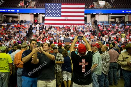 Stock Image of Supporters of US President Donald J. Trump take photographs at a Make America Great Again rally at the Landers Center in Southaven, Mississippi, USA, 02 October 2018. President Trump has been holding MAGA rallies around the country supporting Republican candidates and speaking about what he believes are the accomplishment of his administration. During this rally, President Trump made statements mocking the testimony of Dr. Christine Blasey Ford, who has accused Supreme Court nominee Brett Kavanaugh of allegedly sexually assulting her when they were in high school.