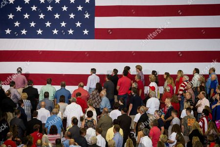 Supporters of US President Donald J. Trump turn to face a flag during the singing of the National Anthem at a Make America Great Again rally at the Landers Center in Southaven, Mississippi, USA, 02 October 2018. President Trump has been holding MAGA rallies around the country supporting Republican candidates and speaking about what he believes are the accomplishment of his administration. During this rally, President Trump made statements mocking the testimony of Dr. Christine Blasey Ford, who has accused Supreme Court nominee Brett Kavanaugh of allegedly sexually assulting her when they were in high school.