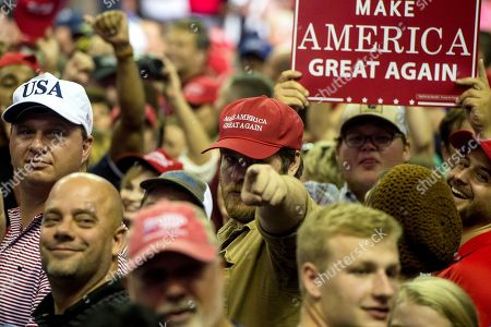 Supporters of US President Donald J. Trump turn to face the press platform after Trump criticized what he called members of the 'fake news' media at a Make America Great Again rally at the Landers Center in Southaven, Mississippi, USA, 02 October 2018. President Trump has been holding MAGA rallies around the country supporting Republican candidates and speaking about what he believes are the accomplishment of his administration. During this rally, President Trump made statements mocking the testimony of Dr. Christine Blasey Ford, who has accused Supreme Court nominee Brett Kavanaugh of allegedly sexually assulting her when they were in high school.
