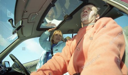 Ep 2654 Friday 18th February 2000 Kathy deduces that Graham killed Rachel. He snaps and grabs the car wheel. Horrified Eric and Marlon watch as the struggle causes the car to veer towards a cliff-edge. Graham becomes hysterical as Kathy attempts to escape. Eric and Marlon helplessly watch as the car plummets to the beach and explodes.... With Graham Clark, as played by Kevin Pallister ; Kathy Glover, as played by Malandra Burrows.
