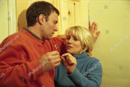 Ep 2654 Friday 18th February 2000 Graham tries to persuade Kathy to move away from the village permanently with him, but she says she's not ready to commit to a relationship. He locks her in the room with him and tells her he needs to talk to her. He claims Eric and Marlon are making his life a misery, blaming him for Rachel's death. Kathy starst to get suspicious - With Graham Clark, as played by Kevin Pallister ; Kathy Glover, as played by Malandra Burrows.