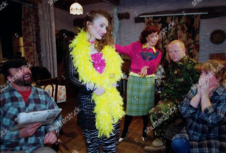 Ep 2656 Wednesday 23rd February 2000 Nellie upsets Lisa again when she gives Emily an extreme over-the-top makeover - With Nellie Dingle, as played by Maggie Tagney; Zak Dingle, as played by Steve Halliwell ; Lisa Dingle, as played by Jane Cox ; Emily Wylie, as played by Kate McGregor, and Butch Dingle, as played by Paul Loughran.