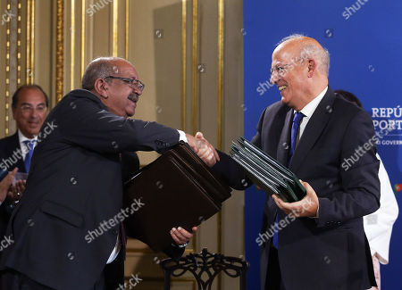 Portuguese Foreign Affairs Minister Augusto Santos Silva (R) greets his Algerian counterpart Abdelkader Messahel (L) during their Portuguese-Algerian Summit in Lisbon, Portugal, 03 October 2018. Both sides signed various bilateral agreements on aviation, tourism, geology and mining.