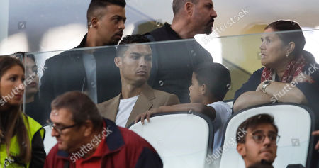 "Juventus forward Cristiano Ronaldo, center, flanked by his girlfriend Georgina, left, looks at his son Cristiano Jr, as his mother Dolores Aveiro sits at right, during a Champions League, group H soccer match between Juventus and Young Boys, at the Allianz stadium in Turin, Italy, . A lawyer for a Nevada woman alleging that soccer star Cristiano Ronaldo raped her in Las Vegas in 2009 said Tuesday her client was ""emotionally fragile"" and agreed to an out-of-court financial settlement nine years ago because she never wanted her name made public"