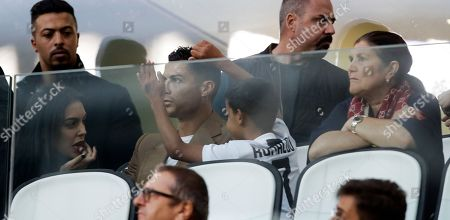 "Stock Picture of Juventus forward Cristiano Ronaldo, center, is flanked by his girlfriend Georgina, left, his son Cristiano Jr, and his mother Dolores Aveiro, right, as he attends a Champions League, group H soccer match between Juventus and Young Boys, at the Allianz stadium in Turin, Italy, . A lawyer for a Nevada woman alleging that soccer star Cristiano Ronaldo raped her in Las Vegas in 2009 said Tuesday her client was ""emotionally fragile"" and agreed to an out-of-court financial settlement nine years ago because she never wanted her name made public"