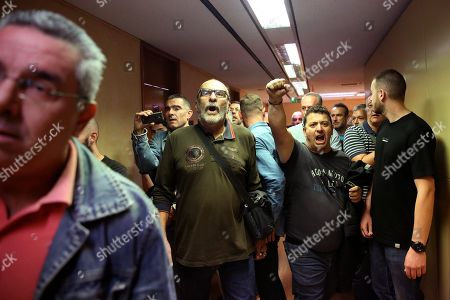 Public sector workers have broken into the meeting room of the Finance Ministry demanding a meeting with Finance Minister Euclid Tsakalotos, in Athens, Greece, 03 October 2018. Public sector workers are on a 24-hour strike opposing reforms in the pension system.