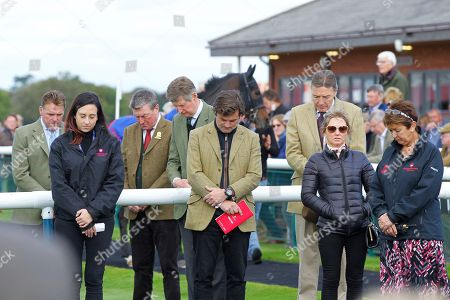 Richard Thomas [2nd left] Chester and Bangor Managing Director and Jeannie Chantler [right] Bangor-on-Dee General Manager observe a minutes silence after the death of Chairman / Director Sir Charles Lowther.