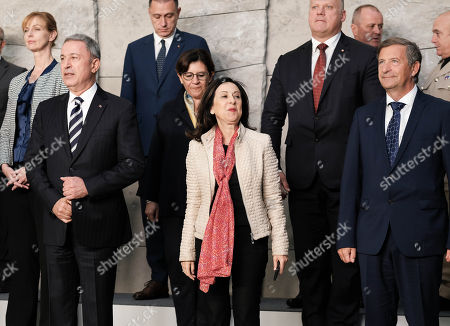 (Front row, L-R) Turkey's Defense Minister Hulusi Akar, Spanish Defense Minister Margarita Robles and Slovenia Defense Minister Karl Erjavec take their position for a group photo during the Nato Defense Ministers taken of them on the sidelines of a council meeting at the North Atlantic Treaty Organization (NATO) headquarters in Brussels, Belgium, 03 October 2018. Others are not identified.