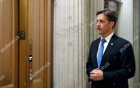 Sen. Ben Sasse, R-Neb., waits for the elevator after speaking on the Senate floor, on Capitol Hill, in Washington
