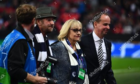 The wife and son of Chas Hodges, of Chas and Dave fame, on the pitch at half time