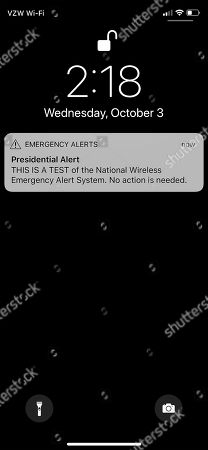 A screenshot showing a 'Presidential Alert' test message appears on the screen of a Apple iPhone X as the US Federal Emergency Management Agency (FEMA) tested its nationwide wireless emergency alert system on a majority of wireless devices in the US in Norfolk, Massachusetts, USA, 03 October 2018. The test, which cannot be opted out of unlike weather alerts or AMBER alerts which users can chose not to receive, has generated complaints and even a lawsuit in New York to attempt to stop it.