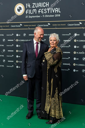 """British actress Judi Dench (R) and David Parfitt, actor and film producer pose on the Green Carpet, before the screening of the movie """"Red Joan"""" at the 14th Zurich Film Festival (ZFF) in Zurich, Switzerland, 03 October 2018. The festival runs from 27 September to 07 October."""