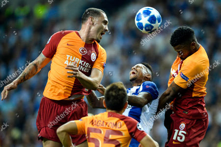 FC Porto's Eder Militao (C) in action against Galatasaray's Maicon (L), Yuto Nagatomo (bottom) and Ryan Donk (R) during the UEFA Champions League group D soccer match between Porto and Galatasaray at the Dragao stadium, Porto, Portugal, 03 October 2018.