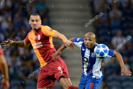 FC Porto's Yacine Brahimi (R) fights for the ball with Galatasaray's Maicon during the UEFA Champions League group D soccer match between Porto and Galatasaray at the Dragao stadium, Porto, Portugal, 03 October 2018.