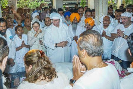 Bollywood actors Randhir Kapoor, Kareena Kapoor and industralist Anil Ambani during Krishna Raj Kapoor funeral at Chembur