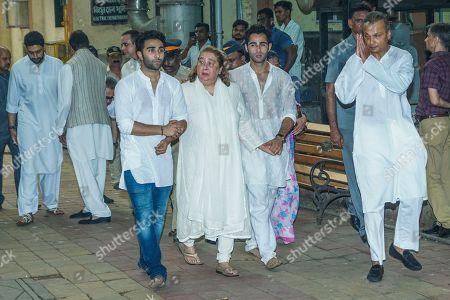Raj Kapoor's daughter Rima Jain with Industrialist Anil Ambani during Krishna Raj Kapoor funeral at Chembur
