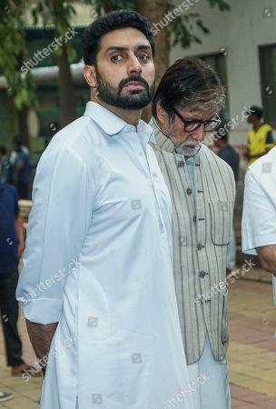 Bollywood actors Amitabh Bachchan and Abhishek Bachchan during Krishna Raj Kapoor funeral at Chembur