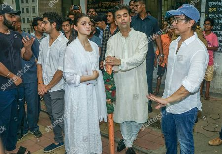 Bollywood actors Aamir Khan and Alia Bhatt with filmmaker Karan Johar during Krishna Raj Kapoor funeral at Chembur