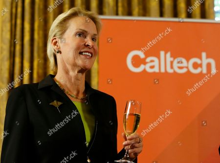 Nobel chemistry winner Frances Arnold makes a toast at California Institute of Technology in Pasadena, Calif