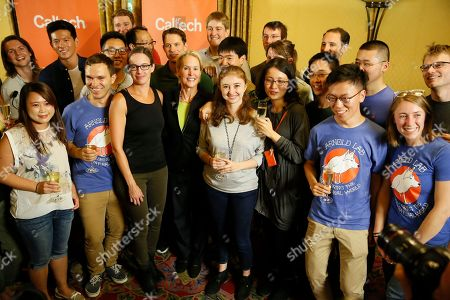 Nobel chemistry winner Frances Arnold, center, takes a photo with her Caltech Arnold Lab students at California Institute of Technology in Pasadena, Calif