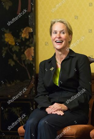 Nobel chemistry winner Frances Arnold celebrates her prize with her students and fellow faculty members at the California Institute of Technology in Pasadena, Calif