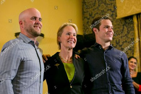 Joseph Lange, Frances Arnold, James Bailey. Nobel chemistry winner Frances Arnold, center, with her sons Joseph Lange, left, and James Bailey pose for a photo at the California Institute of Technology in Pasadena, Calif., . Arnold, of Caltech, was awarded half of the 9-million-kronor ($1.01 million) prize, while the other half was shared by George Smith of the University of Missouri and Gregory Winter of the MRC molecular biology lab in Cambridge, England