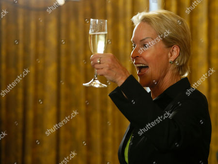 Nobel chemistry winner Frances Arnold toasts at California Institute of Technology in Pasadena, Calif., . Arnold is celebrating her prize with her students and fellow faculty members at Caltech. The 62-year-old shared the Nobel for her work on the directed evolution of antibodies with Cambridge University scientist Greg Winter and George Smith of the University of Missouri