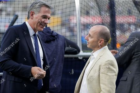 Billy Beane, Brian Cashman. New York Yankees general manager Brian Cashman, right, talks with Oakland Athletics' Executive Vice President of Baseball Operations Billy Beane before the American League wildcard playoff baseball game, in New York