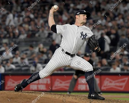 New York Yankees relief pitcher David Robertson delivers against the Oakland Athletics during the seventh inning of the American League wild-card playoff baseball game, in New York