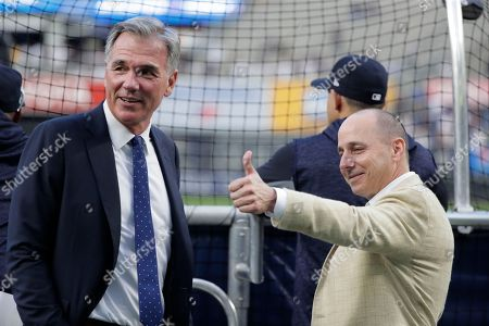 Billy Beane, Brian Cashman. New York Yankees general manager Brian Cashman talks with Oakland Athletics' Executive Vice President of Baseball Operations Billy Beane before the American League wildcard playoff baseball game, in New York