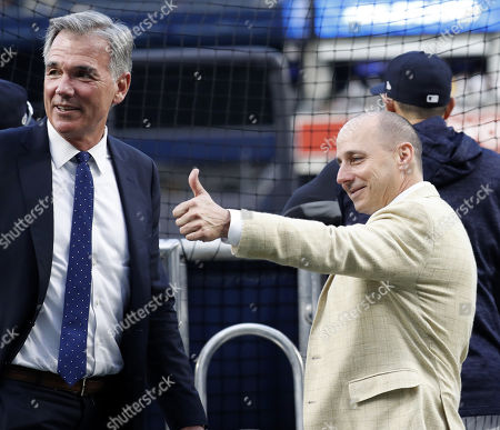 New York Yankees general manager Brian Cashman (R) and Oakland Athletics Executive VP of Baseball Operations Billy Beane (L) look on behind the batting cage before the one-game elimination MLB Wildcard playoff game between the Oakland Athletics and the New York Yankees, at Yankees Stadium in New York, New York, USA, 03 October 2018.