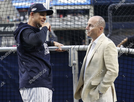New York Yankees general manager Brian Cashman (R) and Yankees manager Aaron Boone (L) talk behind the batting cage before the one-game elimination MLB Wildcard playoff game between the Oakland Athletics and the New York Yankees, at Yankees Stadium in New York, New York, USA, 03 October 2018.