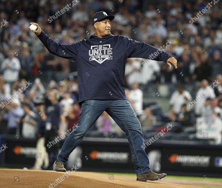 Former New York Yankees player Bernie Williams throws out the ceremonial first pitch before the one-game elimination MLB Wildcard playoff game between the Oakland Athletics and the New York Yankees, at Yankees Stadium in New York, New York, USA, 03 October 2018.