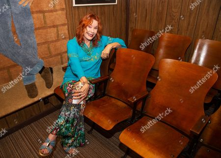 Stock Photo of Miss Pamela Des Barres poses for portraits before her creative writing workshop at the James Dean Gallery, in Fairmont, Ind